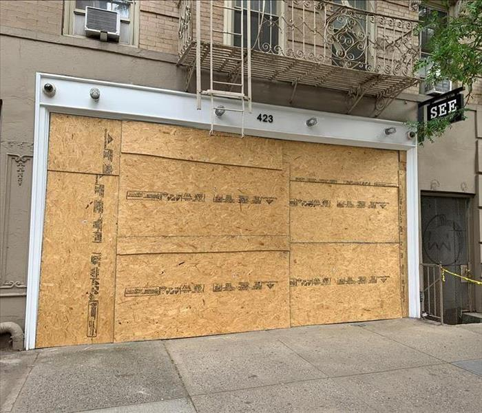 storefront boarded up with plywood