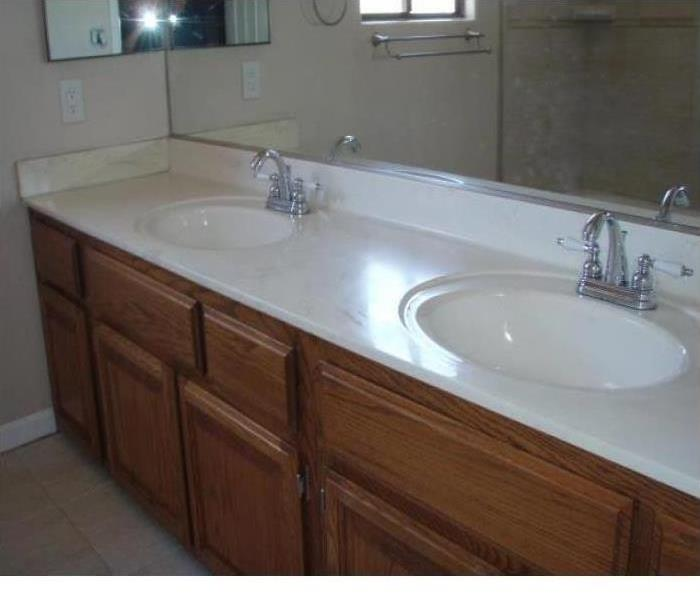 Clean bathroom with white sinks