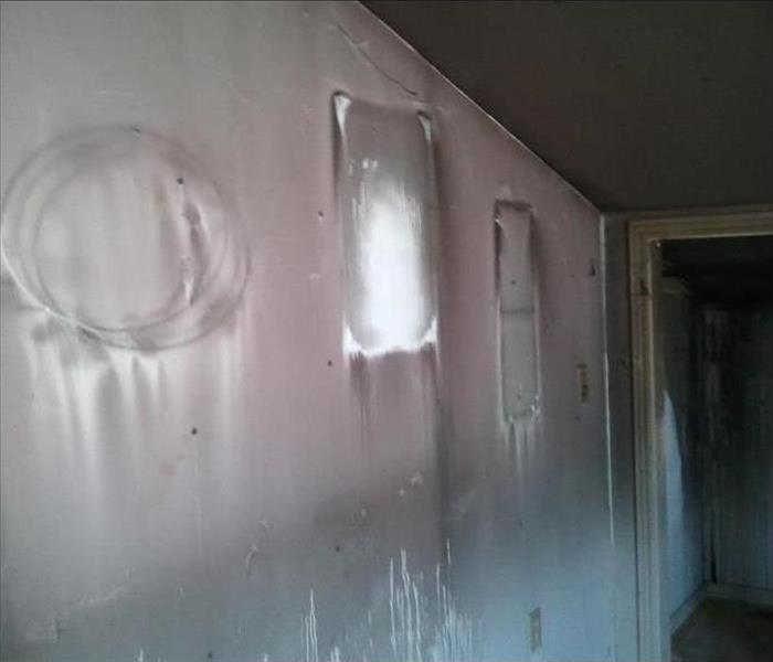 sooty black stains on walls showing where pictures removed from the walls