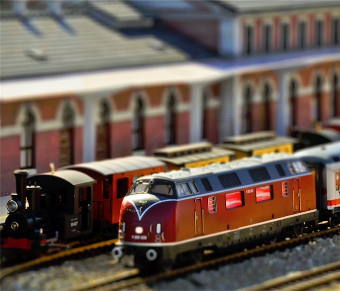 toy trains on train tracks