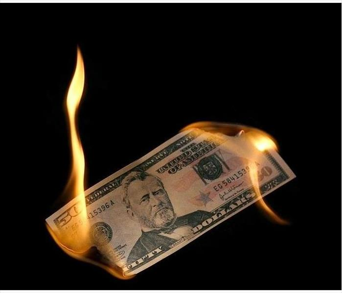 Fifty dollar bill burning on both ends